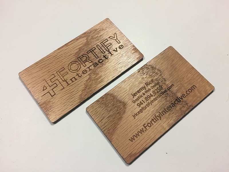 Laser engraved business cards on wood metal plastic starting at oak wood colourmoves